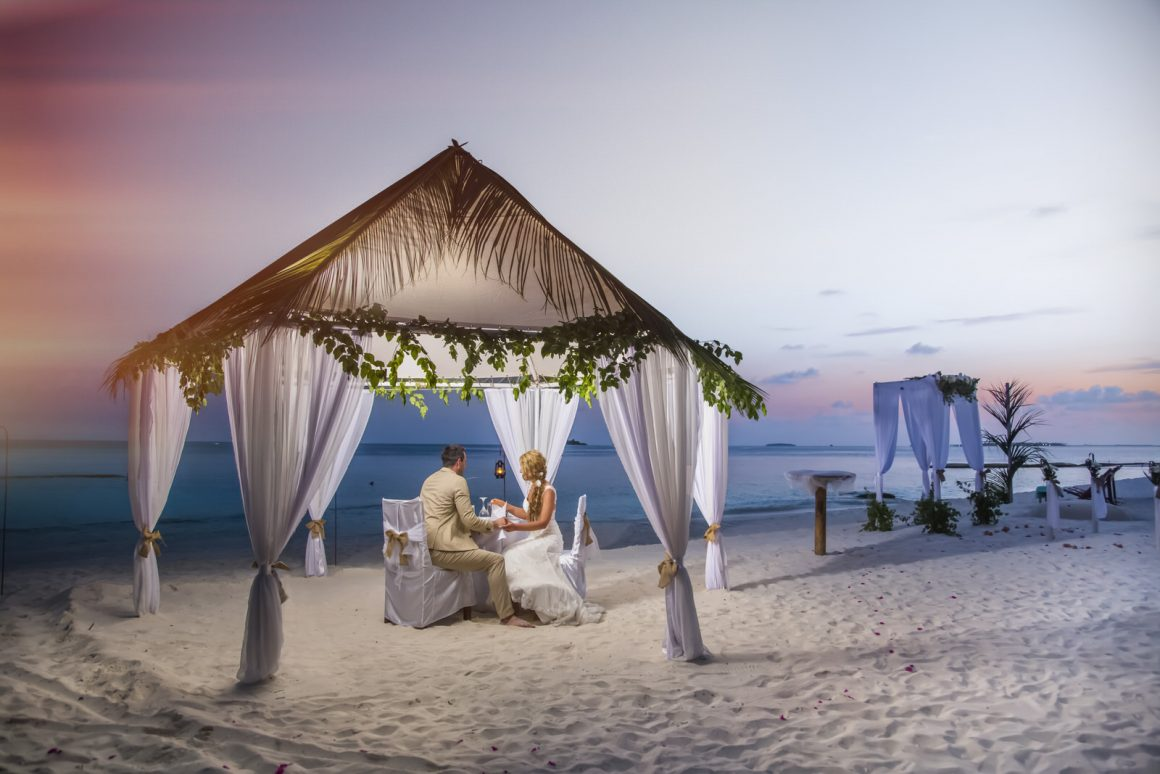 photography of romantic sunset Wedding dinners in maldives