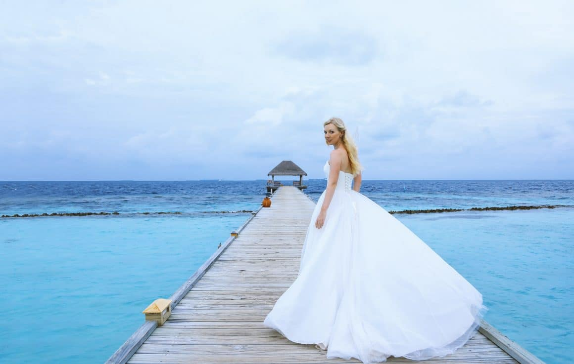 wedding brides photography walking on maldives jetty